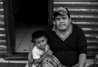 The Migrant Caravan - Tony and his son Alex